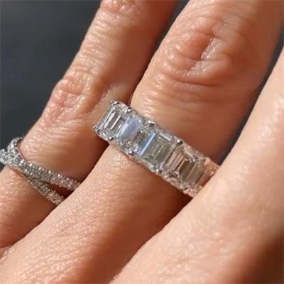 8.00tcw Emerald Moissanite Forever One Colorless Eternity Ring